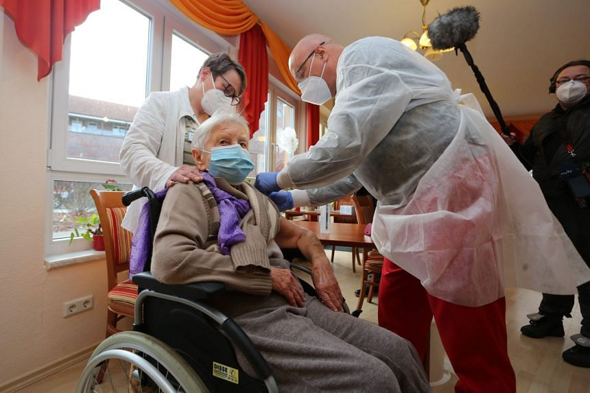 Madam Edith Kwoizalla receives the first Covid-19 vaccination at a senior care facility in Halberstadt, northern Germany, on Dec 26, 2020.