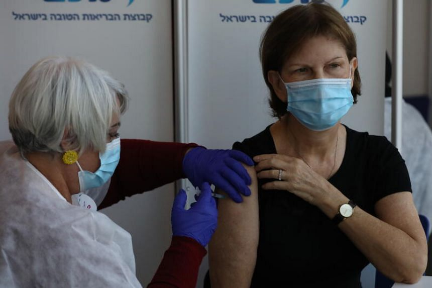 A woman receiving the Covid-19 vaccine at a hospital in Tel Aviv, Israel, on Dec 22, 2020.