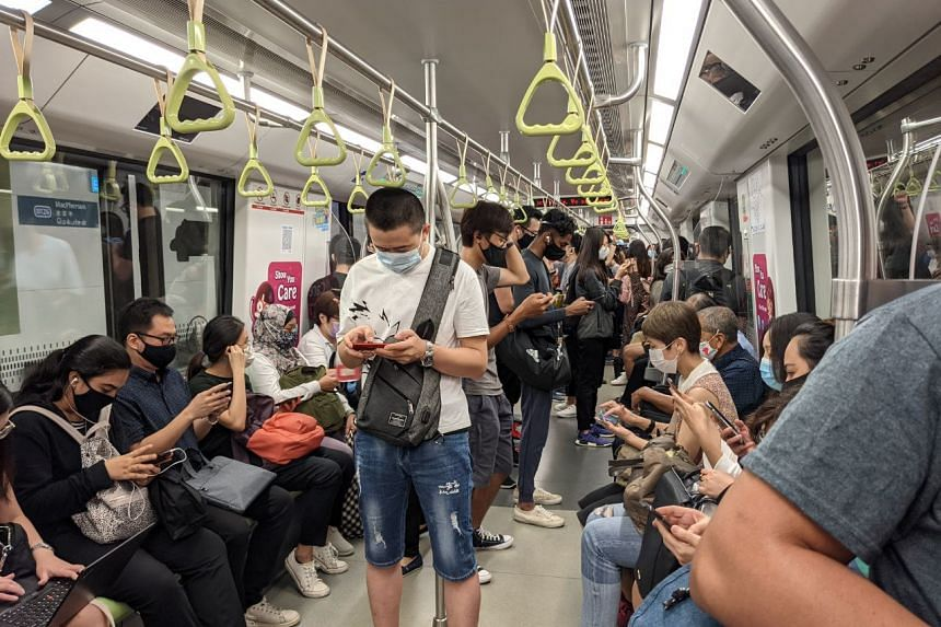 Commuters on board a Downtown Line train at MacPherson MRT station during the delay, on Dec 28, 2020.