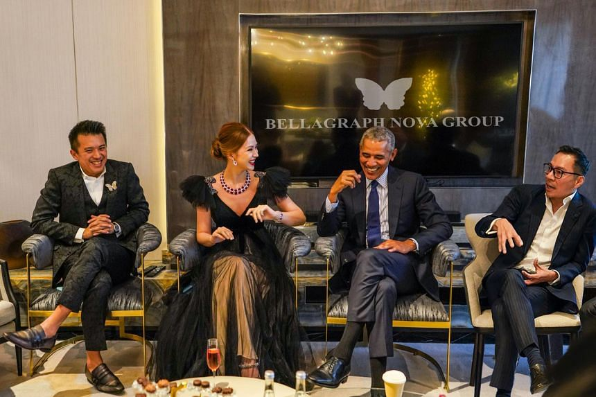 This doctored image of former US president Barack Obama with (from left) Mr Nelson Loh, Ms Evangeline Shen and Mr Terence Loh was released by the Bellagraph Nova Group.