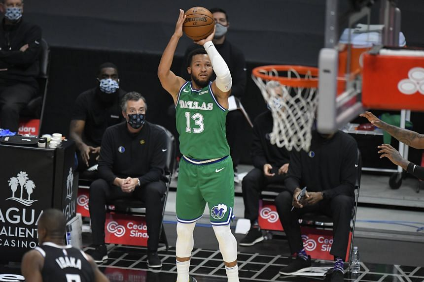 Jalen Brunson #13 of the Dallas Mavericks shoots a three pointer against the Los Angeles Clippers in the first half at Staples Center on Dec 27, 2020.