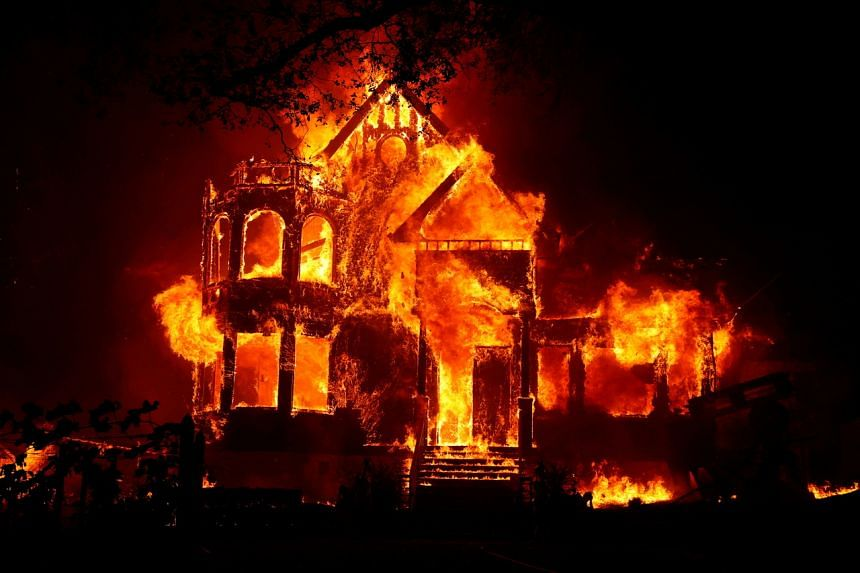 A home is seen fully engulfed in flames during the Glass Fire in St. Helena, California, US on Sept 27, 2020.