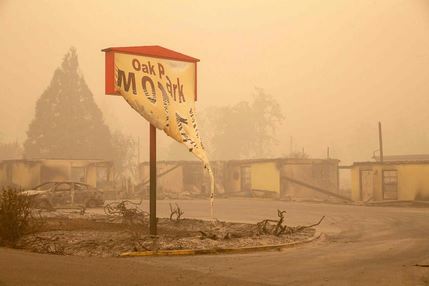 The melted sign of the Oak Park Motel destroyed by the flames of the Beachie Creek Fire is seen in Gates, east of Salem, Oregon, on Sept 13, 2020.