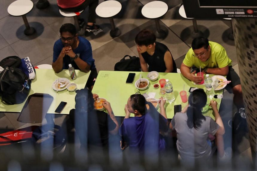 A group of six diners at a Hawker Centre @ Our Tampines Hub on Dec 28, 2020.
