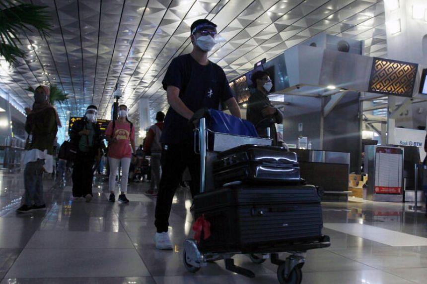 Passengers at the Soekarno-Hatta Airport, in Tangerang, Indonesia, on Dec 23, 2020.
