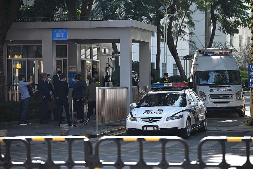 Diplomats from the US, Britain, Australia, Canada, Portugal and the Netherlands outside the Yantian District People's Court in Shenzhen yesterday, where 10 Hong Kong pro-democracy activists were to face trial. The 10 - along with two others who are m