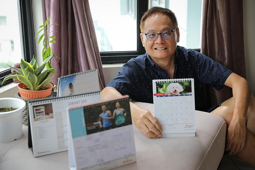 Mr Peter Lim, who has been using desk calendars for years, with his old and new calendars.
