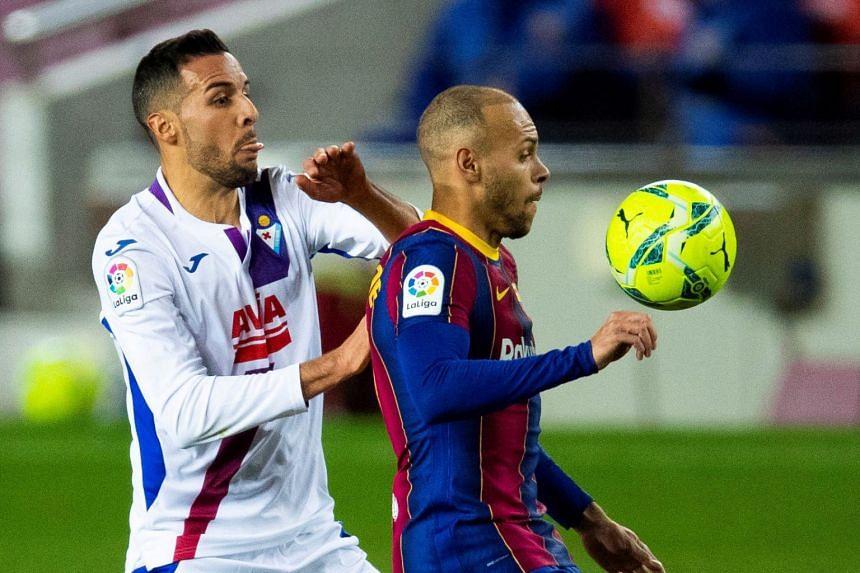 Barcelona's Martin Braithwaite (right) vies for the ball with Eibar defender Esteban Burgos.