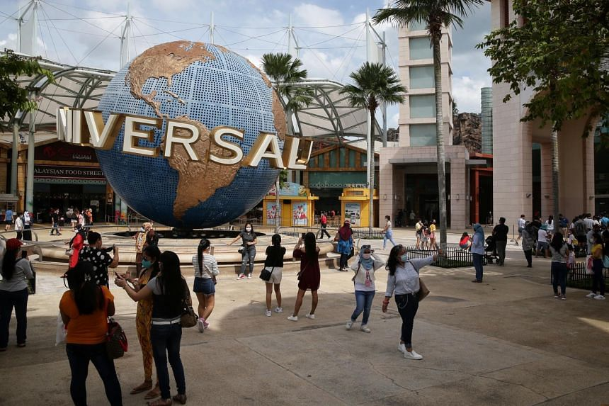 Visitors taking photos in front of Universal Studios at Sentosa on Dec 6, 2020.
