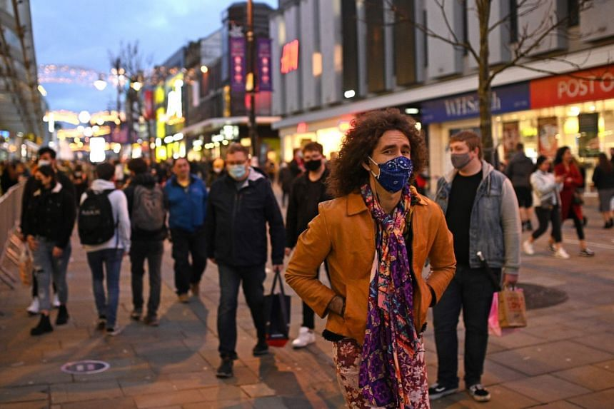 Pedestrians walk through central Newcastle-upon-Tyne, in north-east England, on Dec 19, 2020,