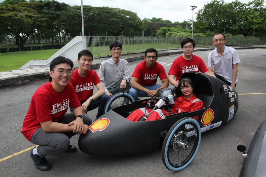 Temasek Polytechnic's Shell Eco Car team posing with the TP Eco Flash, a hydrogen-powered car designed and built for the Shell Eco-Marathon Asia race. The team received the Technical Innovation Award for its innovative design and engineering excellen