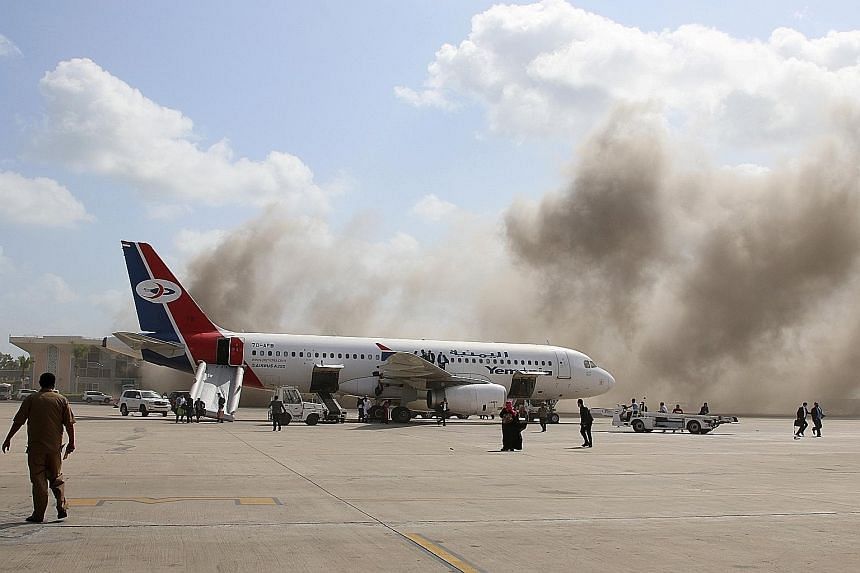 Blasts and gunfire were heard at Aden airport yesterday, shortly after a plane carrying a newly formed Cabinet for government-held parts of Yemen arrived from Saudi Arabia. A local security source said three mortar shells landed on the airport's hall