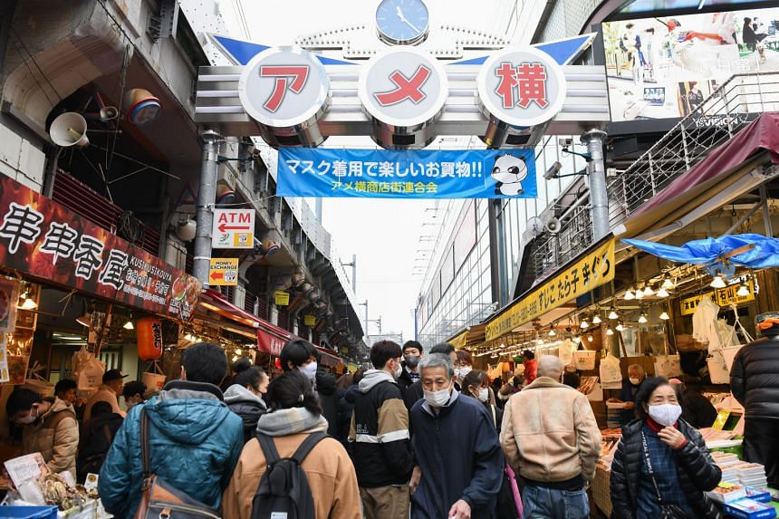 A crowded street at the Ameya Yokocho market in the Ueno district of Tokyo yesterday. The Japanese capital recorded 944 new coronavirus cases yesterday, just under the record 949 recorded on Saturday, and medical experts warned that unless the outbre