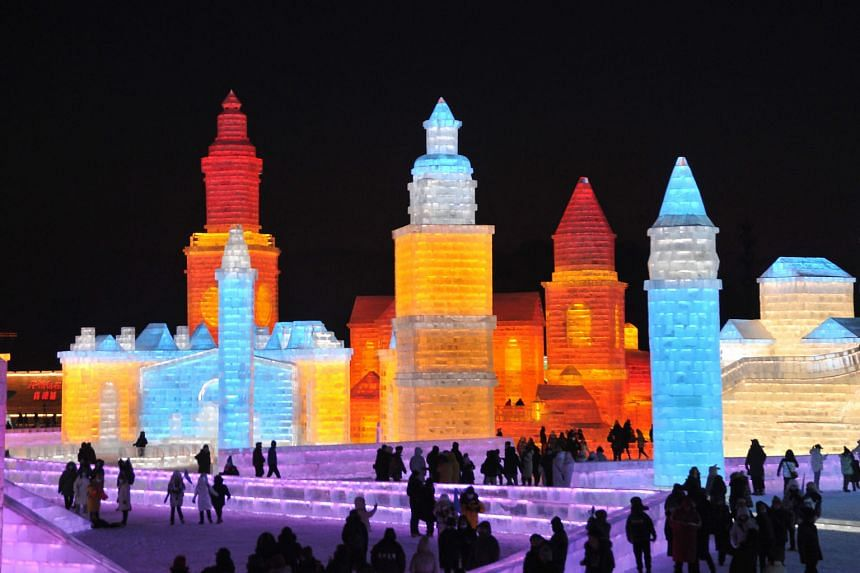 Tourists looking at ice sculptures ahead of the Harbin International Ice and Snow Festival in Harbin, in north-eastern China's Heilongjiang province, on Dec 24. Recent Covid-19 cases in Beijing and northern China have rekindled public concern, alread