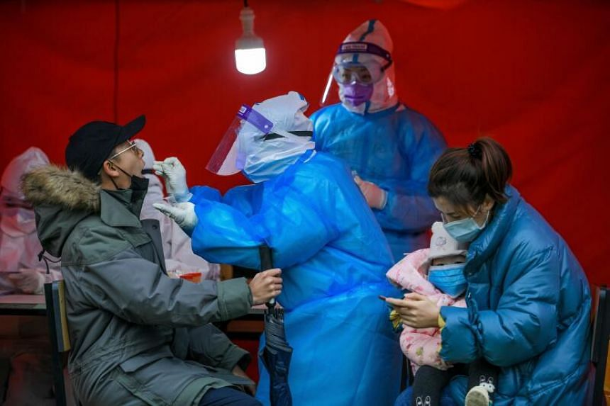 The first patient in China with the new variant is a woman from Shanghai who arrived from Britain on Dec 14, 2020.