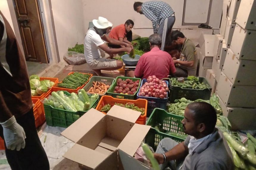 Vegetables being sorted and packaged in Pune district before being sent to the dabbawalas for delivery in Mumbai.