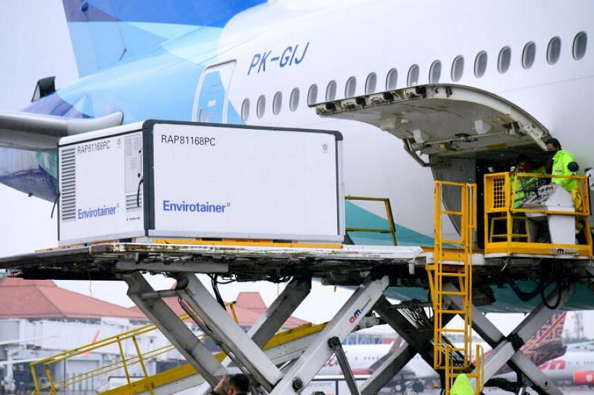 Workers unloading a container with Sinovac's Covid-19 vaccine at Soekarno-Hatta International Airport on Dec 31, 2020.