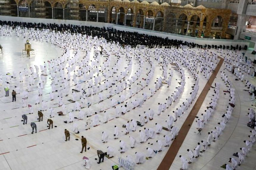 Worshippers pray around the Kaaba in the Grand Mosque complex in Mecca on Nov 1, 2020.