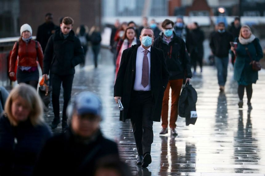 People walk across London Bridge in Britain's capital on Dec 15, 2020.