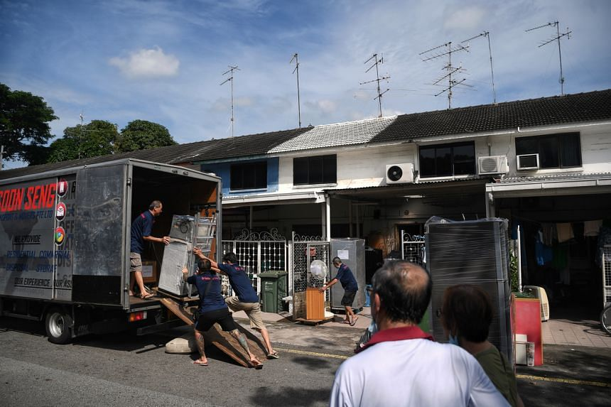 Workers moving the belongings from out of the house of Madam Yeo Ai, in Geylang Lorong 3 on Nov 21, 2020.