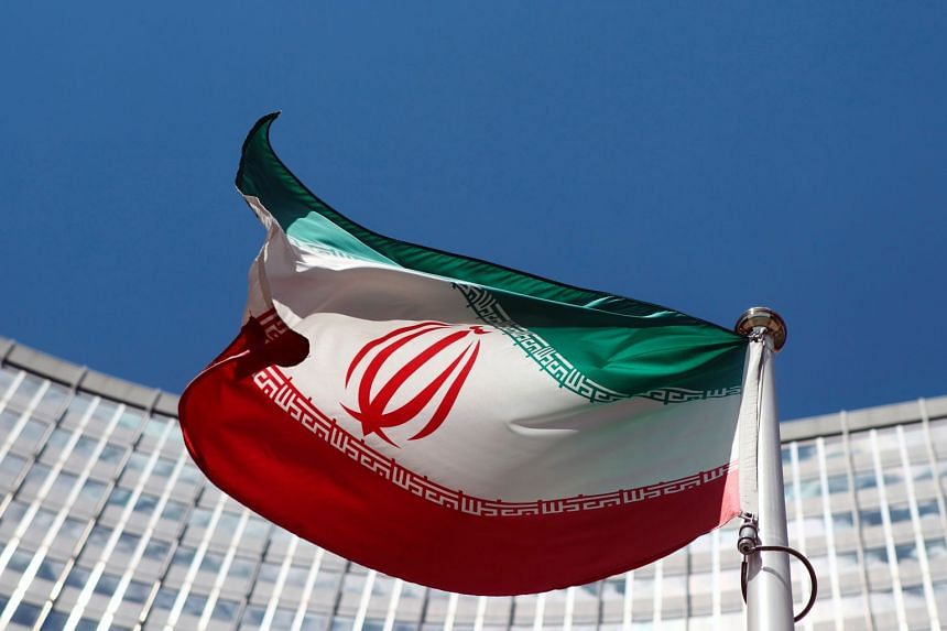 An Iranian flag flutters in front of the United Nations headquarters in Vienna.