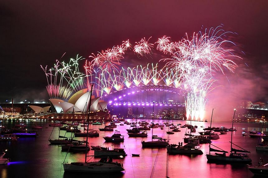 SYDNEY Fireworks exploding over the Sydney Opera House and Sydney Harbour Bridge. Unlike in past years, the harbour below was a deserted ghost town amid the Covid-19 pandemic.