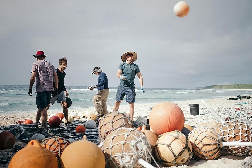 Mr Brett Howell (right), one of the leaders of a project to clear plastic that ended up on Henderson Island in the South Pacific.