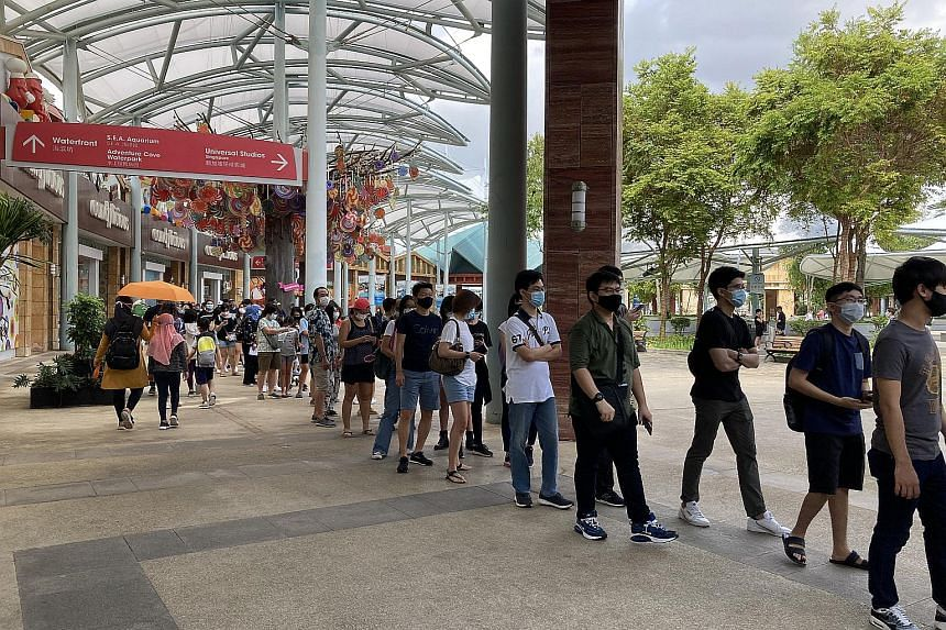 A queue of more than 300 people was seen waiting to enter Universal Studios Singapore at 2.30pm on Dec 28, 2020.