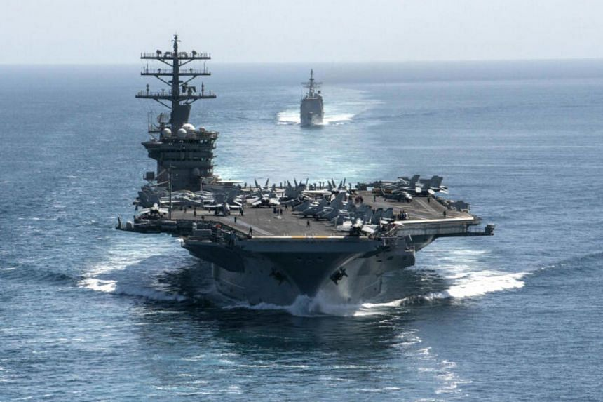 The aircraft carrier USS Nimitz and the guided-missile cruiser USS Philippine Sea in formation during a Strait of Hormuz transit, Sept 18, 2020.