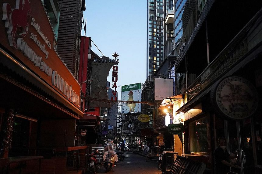 Shuttered go-go bars and massage parlours in Bangkok yesterday after the city authorities ordered a partial lockdown of various public facilities. Public schools will be closed for two weeks, while more than a dozen virus checkpoints have been set up