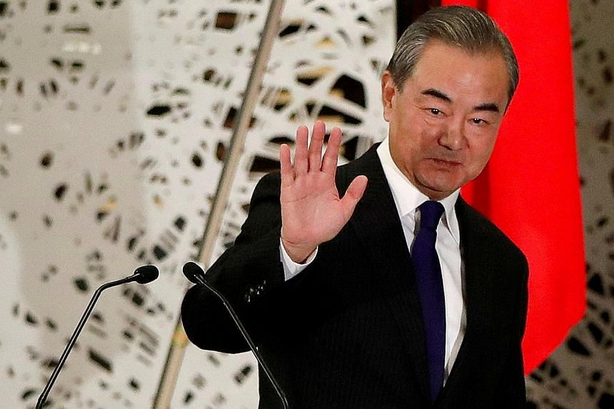 """China's State Councillor Wang Yi, who is also Foreign Minister, said there is now an opportunity for China and the US to """"open a new window of hope"""" and begin a new round of dialogue. PHOTO: REUTERS"""