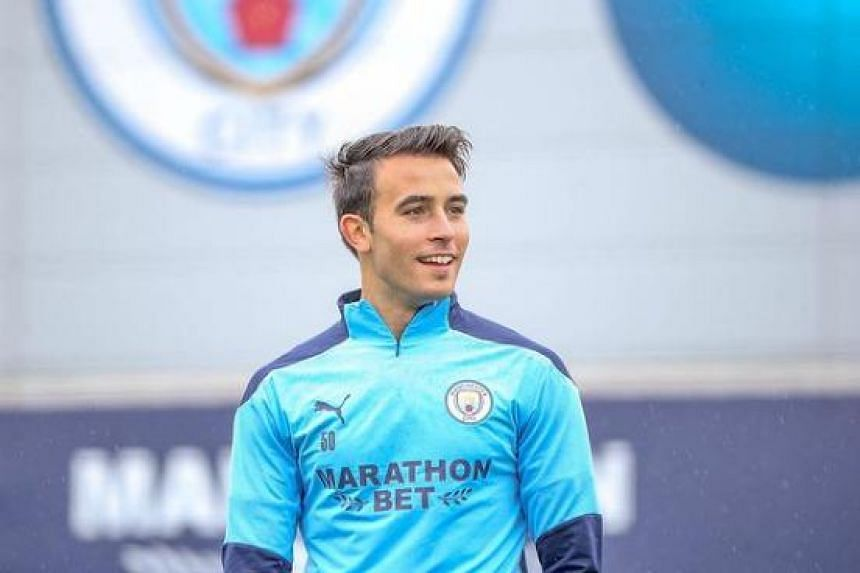 Manchester City defender Eric Garcia (above) and a staff member have tested positive for Covid-19,