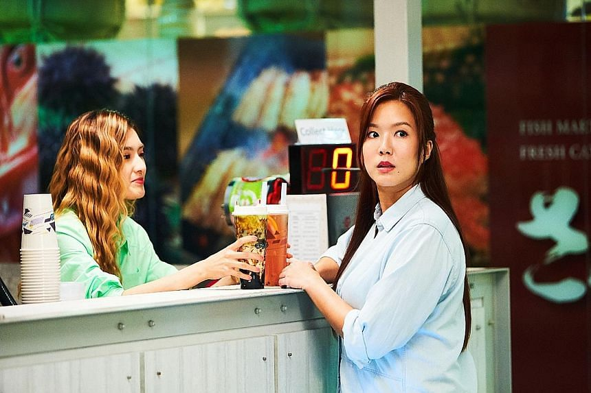 Hong Ling (left) and Rui En (right) at a bubble-tea stall in Mister Flower.