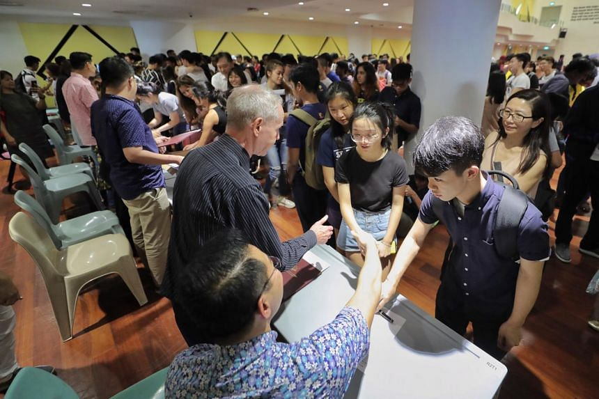 In a photo from Jan 3, 2020, students from Anglo-Chinese School (Independent) receive their International Baccalaureate diploma exams results.
