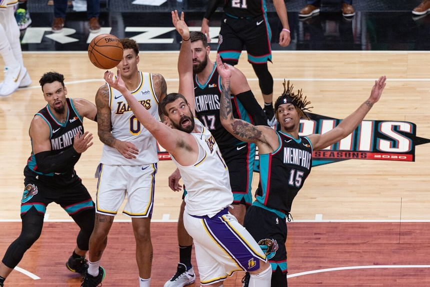 Los Angeles Lakers' Marc Gasol (centre) and Memphis Grizzlies forward Brandon Clarke (right) fight for the ball during the game on Jan 3, 2021.