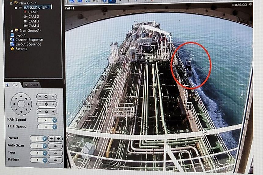 CCTV footage of the Hankuk Chemi shows Revolutionary Guards (circled).