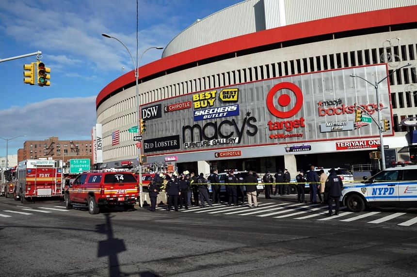 Police outside the Queens Place Mall parking garage, where a fake bomb was placed, in New York, on Jan 4, 2021.