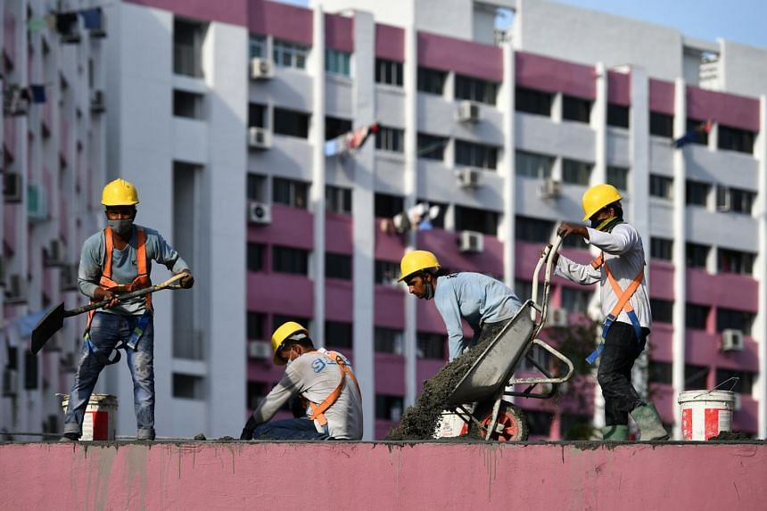 Construction workers working on the roof of a walkway at Blk 4 Queen's Road, on Nov 5, 2020.
