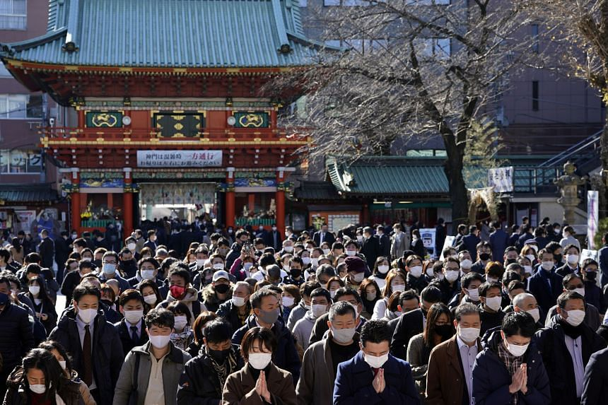 "People offering prayers for prosperity for their companies and the economy during the start of the new year at the Kanda Myojin Shrine in Tokyo yesterday. Japanese Prime Minister Yoshihide Suga said that ""stronger messaging"" was needed to make people"