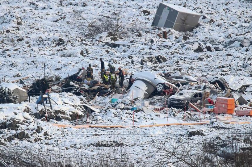 Rescue workers on the site of a major landslide in Norway, on Jan 5, 2021.