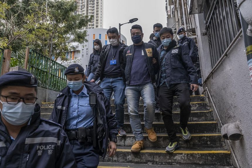 Police escort Andrew Wan, a pro-democracy politician in Hong Kong on Jan 6, 2021.