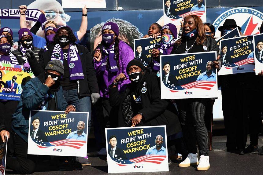 Supporters of US Democratic candidates Raphael Warnock and Jon Ossoff in Marietta, Georgia, on Jan 5, 2021.