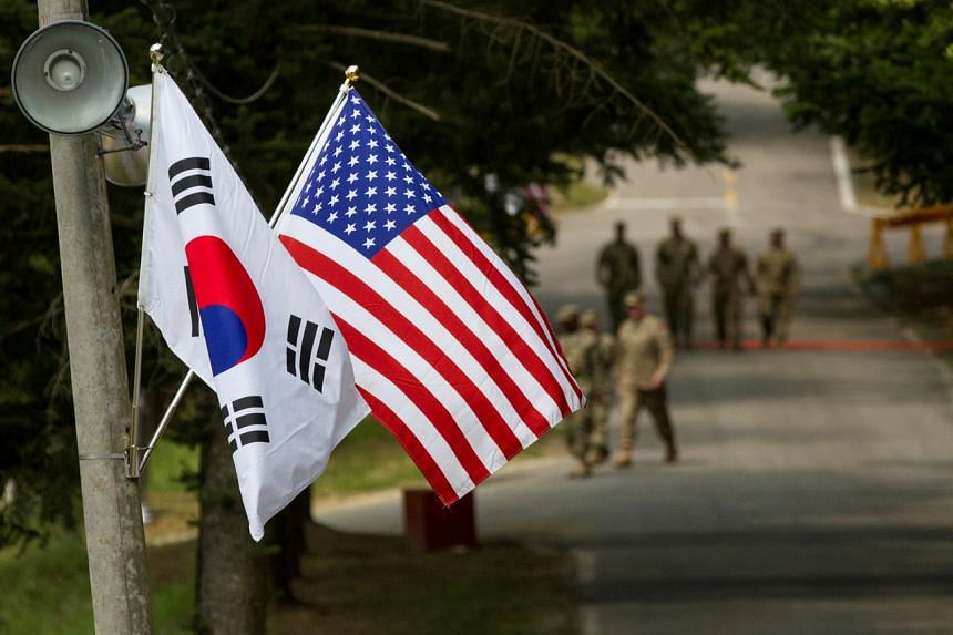 The South Korean and American flags fly next to each other at Yongin, South Korea, on Aug 23, 2016.