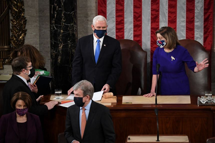 Pence and Speaker of the House Nancy Pelosi take part in a joint session of Congress to certify the 2020 election results on Jan 6, 2020.