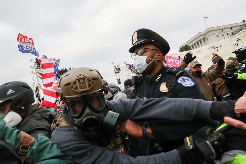 Supporters of US President Donald Trump clash with police officers in front of the US Capitol in Washington on Jan 6, 2021.