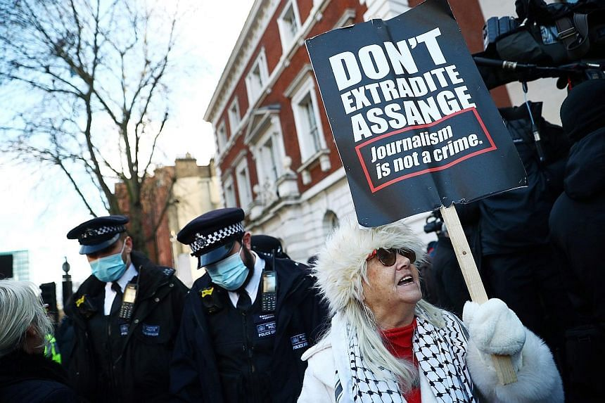 A supporter of Julian Assange outside the Westminster Magistrates Court yesterday. PHOTO: REUTERS