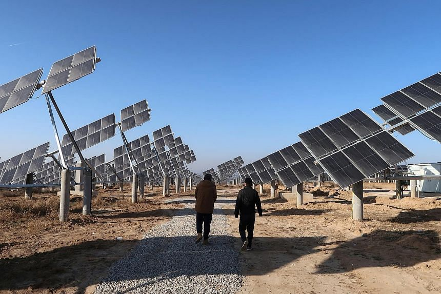 A solar power station in Tongchuan, Shaanxi province, in 2019. China's President Xi Jinping has pledged to raise wind and solar capacity to 1,200 gigawatts by 2030. PHOTO: REUTERS