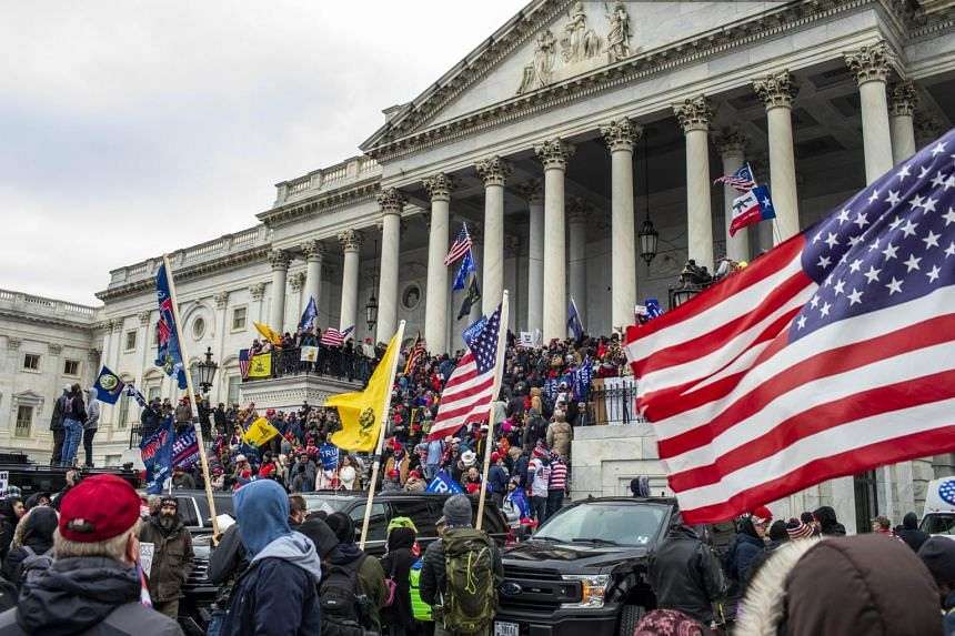 Protesters breached security and entered the Capitol building in Washington on Jan 6, 2021.