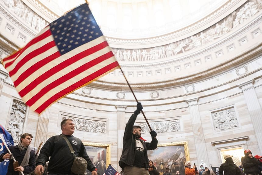 Supporters of US President Donald Trump in the Capitol Rotunda after breaching Capitol security in Washington on Jan 6, 2021.
