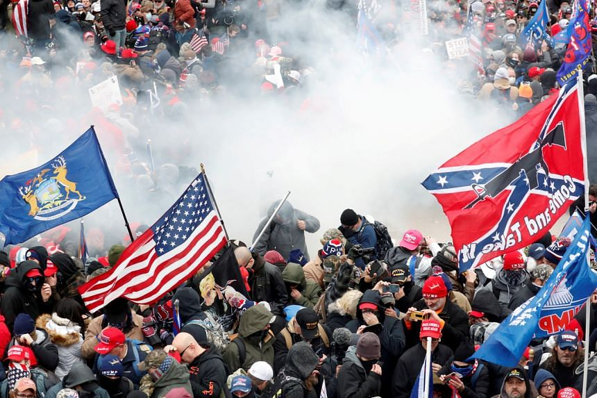 Tear gas being released into a crowd of protesters during clashes with Capitol police in Washington on Jan 6, 2021.